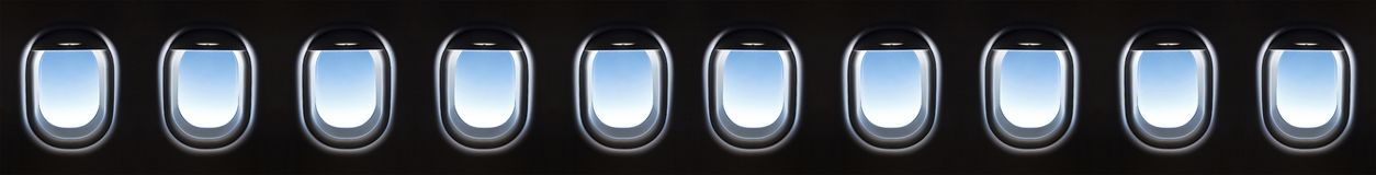 Airplane window 10 and Fantastic soft white clouds against blue royalty free stock images