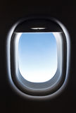 airplane window and Fantastic soft white clouds against blue sky Royalty Free Stock Image