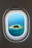 Airplane window from interior of aircraft. Stock Image