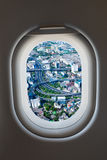 Airplane window from interior of aircraft with high way view. Royalty Free Stock Image