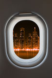 Airplane window from interior of aircraft. Stock Photo