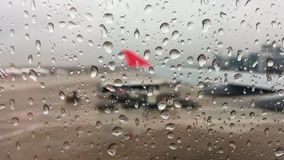Airplane window with raindrops stock video footage
