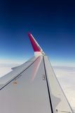 Airplane Window Seat View Over Wing Whilst Flying Stock Photo