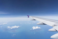 Airplane window. View from airplane window with blue sky and clouds Royalty Free Stock Photos