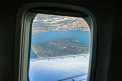 Airplane window, view of Mercer Island Royalty Free Stock Photos