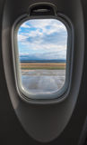 Airplane Window. View on runway before departure Royalty Free Stock Photo