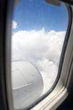 Airplane. Window with a view of sky and clouds Royalty Free Stock Photos