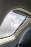 Airplane. Window with a view of sky and clouds Royalty Free Stock Photo