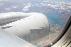 Airplane. Window with a view of sky and clouds Royalty Free Stock Image