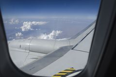 Airplane. Window with a view of sky and clouds Stock Images