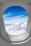 Airplane window view. View through airplane window, sky over the clouds Royalty Free Stock Photo