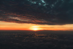 Airplane window view. And sunrise stock photo