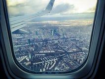 Airplane Windowpane Showing City Buildings stock photos