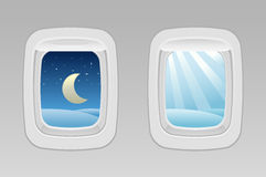 Airplane windows night and day Stock Photos