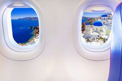 Airplane windows with Santorini view in Greece. Airplane windows with Santorini island view. Travel to Greece stock image