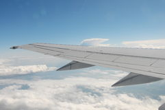 Airplane wing. During flight above clouds Stock Image