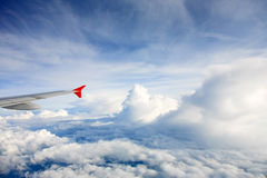 Airplane wing. Above the clouds Royalty Free Stock Photo