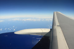 Airplane Wing. Over blue sky and horizon stock photo