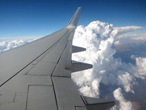 Airplane wing. Sky and clouds stock image