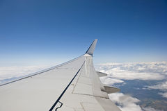 Airplane wing. Aerial view from the airplane. Close up of the plane wing Royalty Free Stock Image