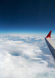 Airplane wing. On the beautiful blue sky background Royalty Free Stock Photography