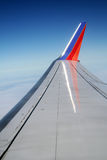 Airplane wing. Tip on blue sky Royalty Free Stock Photo
