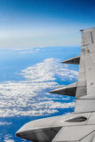 Airplane wing. Aerial shot of blue sky and ocean from inside of airplane flying to HongKong Stock Photo