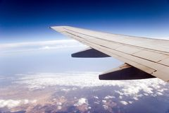 Airplane wing. As seen from a passenger's seat royalty free stock image