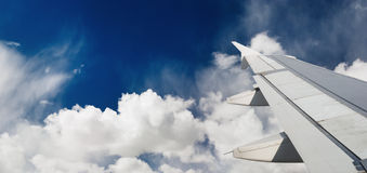 Airplane wing. And blue sky royalty free stock images