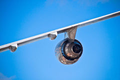 Airplane wing. And turbine and a blue sky royalty free stock photography