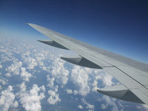 Airplane wing. View from airplane window looking out over the wing Royalty Free Stock Photography