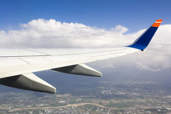 Airplane wing above the city Stock Images