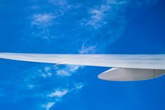 Airplane wing above cloud Royalty Free Stock Images