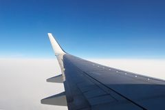 Airplane wing above the clouds Royalty Free Stock Photography