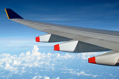 Airplane wing above clouds Stock Photography