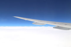 Airplane wing above sky stock image