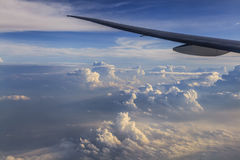 Airplane wing against a background of clouds. View from the wind Royalty Free Stock Images