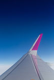Airplane wing against clear blue sky Stock Images