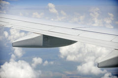 Airplane wing in the air Royalty Free Stock Image