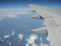 Airplane wing in the atmosphere stock image