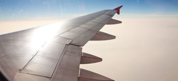 Airplane wing in atmosphere level Royalty Free Stock Photo