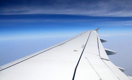Airplane wing on a background of sky and clouds Royalty Free Stock Photography