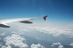 Airplane wing and beautiful clouds Stock Photo