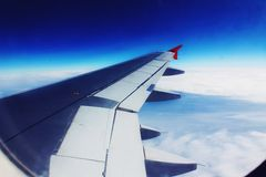 Airplane Wing and Blue Skies. From Window Stock Photo