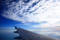 Airplane Wing & Blue Sky. Looking out the Window at the Airplane Wing stock image