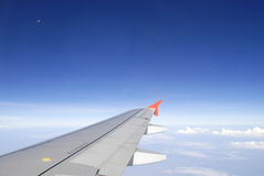 Airplane wing in the blue sky Royalty Free Stock Photo