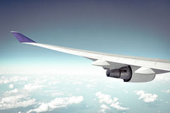 Airplane wing on blue sky background Stock Images
