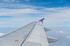 Airplane wing with blue sky Stock Photos