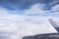 Airplane wing in the blue sky with clouds Royalty Free Stock Photography