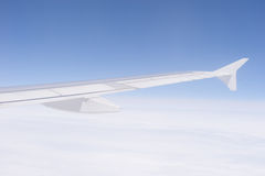 Airplane wing blue sky Stock Photos